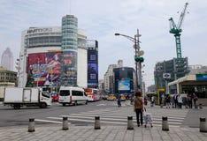 People and vehicles on street in Taipei, Taiwan Stock Photo