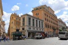 People and vehicles on the street Via Nationale in Rome Stock Photography