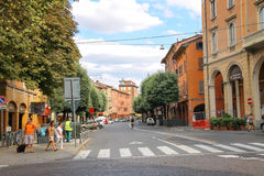 People and vehicles on Via Augusto Righi in Bologna, Italy. Bologna, Italy - August 18, 2014: People and vehicles on Via Augusto Righi in Bologna, Italy Stock Photo