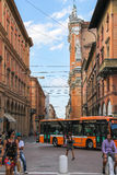 People and vehicles on Via dell'Indipendenza  in Bologna, Italy. Bologna, Italy - August 18, 2014: People and vehicles on Via dell'Indipendenza  in Bologna Stock Images
