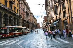 People and vehicles on Via Francesco Rizzoli in Bologna. Bologna, Italy - August 18, 2014: People and vehicles on Via Francesco Rizzoli in Bologna. Italy Stock Image
