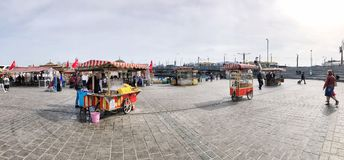People and vendors on Eminonu square in Istanbul, Turkey. Stock Image