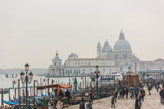 People at Venice with Basilica di Santa Maria della Salute at ba Stock Images