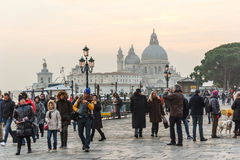 People at Venice with Basilica di Santa Maria della Salute at ba Stock Photo