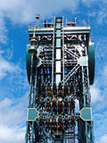 People in vertical drop of dive coaster Stock Photography