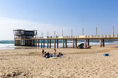 People and Vetchs Pier Against Sea and Skyline Royalty Free Stock Images