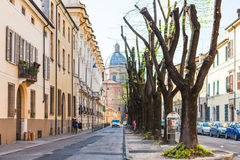 People on Via Carlo Poma and Chiesa in Mantua Stock Image