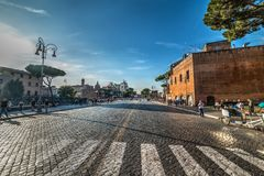 People in Via dei Fori Imperial at sunset. Rome, Italy - October 12, 2017: People in Via dei Fori Imperial at sunset Royalty Free Stock Photography