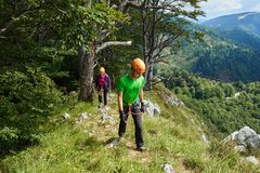 People in via ferrata equipment. After climbing to the top Royalty Free Stock Photos