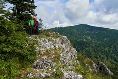 People in via ferrata equipment. After climbing to the top Royalty Free Stock Photo