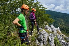 People in via ferrata equipment. After climbing to the top Stock Image