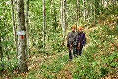People in via ferrata equipment. On a trail to the climbing spot Stock Images