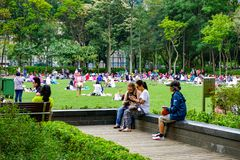 People in Victoria park, Hong kong. A lot of people, tourists and native are walk, meet each other, picnic and have a rest in summer Victoria park Hong kong royalty free stock image