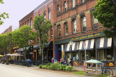 People on Victoria Row in Charlottetown in Prince Edward Island. People walking on Victoria Row block in historic Charlottetown in Prince Edward Island.nPhoto Stock Photos