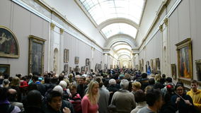 People view the gallery paintings in Louvre Museum, Paris,. PARIS - JAN 02: People view the gallery paintings on January 02, 2014 in Louvre Museum, Paris, France stock footage