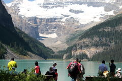Hikers on shores of Moraine Lake, Alberta, Canada Royalty Free Stock Photos