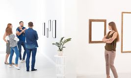 People viewing exposition. In modern art gallery stock images
