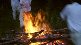 People of the village practice a pagan ritual of cleansing fires stock footage