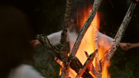 People of the village practice a pagan ritual of cleansing fires stock video