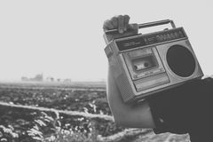 People with vintage radio or cassette recoder Stock Images