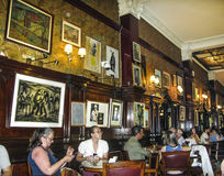 People visit the ancient Cafe Tortoni in Buenos Aires Royalty Free Stock Images
