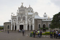 People visit Basilica de Nuestra Senora de los Angeles in Cartago in Costa Rica. CARTAGO, COSTA RICA - JUNE 17, 2012: Unidentified people visit Basilica de Stock Image