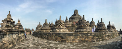 People visit the Borobudur temple, Indonesia. Construction of Buddhist temples, including Borobudur, at that time was possible because Sanjaya's immediate Stock Images