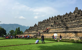People visit the Borobudur temple in Jogja, Indonesia. Borobudur, or Barabudur, is a 9th-century Mahayana Buddhist Temple in Magelang, Central Java, Indonesia Royalty Free Stock Photos