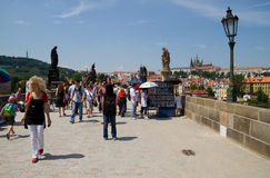People visit the Charles Bridge in Prague. Stock Images