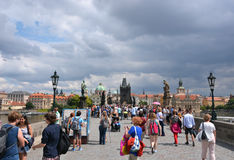 People visit the Charles Bridge in Prague Stock Photos