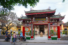 People visit Chinese temple at the ancient town in Hoi An, Vietnam Royalty Free Stock Photo