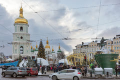 Christmas fair in Kiev, Ukraine. People visit Christmas fair in front of Saint Sophia Cathedral bell tower. Saint Sophia Cathedral is an outstanding Royalty Free Stock Photography