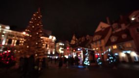 People visit Christmas Fair in old town stock footage