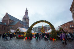 People visit Christmas Fair in old town at evening Stock Photography