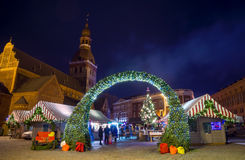 People visit Christmas Fair in old town at evening Royalty Free Stock Photo