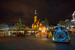 People visit Christmas Fair in old town at evening Stock Images