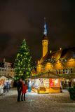 People visit Christmas Fair in old town at evening Royalty Free Stock Photography