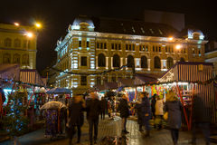 people visit Christmas Fair in old town at evening Stock Image