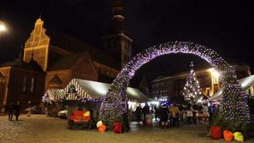 People visit Christmas Fair in old town stock video