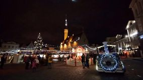 People visit Christmas Fair in old town stock video footage
