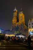 People visit Christmas market at main square in old city Stock Photo