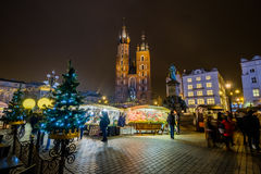 People visit Christmas market at main square in old city Stock Image