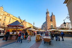 People visit Christmas market at main square in old city Stock Images