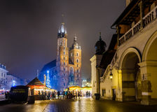 People visit Christmas market at main square in old city Royalty Free Stock Image