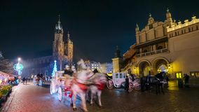 People visit Christmas market at main square in old city stock video footage
