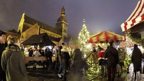 People visit Christmas market in old town stock footage