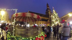 People visit Christmas market in old town stock video footage