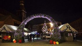 People visit Christmas market in old town stock video