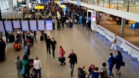 People visit departure hall in international Schiphol airport stock video