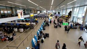 People visit departure hall in international Schiphol airport stock footage